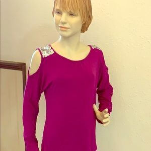 A long sleeved tee with slits on the arms